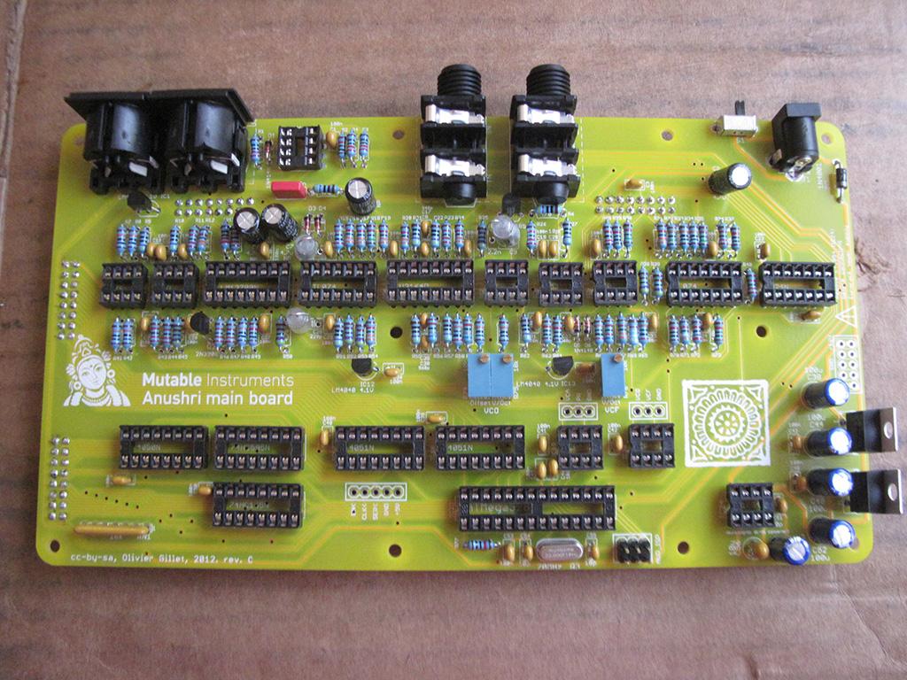 Installing the electrolytic capacitors, voltage regulators, transistors, and jacks on the Mutable Instruments Anushri